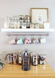 Cute hanging coffee cups, open shelves above