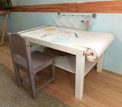 I love this arts and crafts table Ikea hack found on Martha Stewart's  website here .
