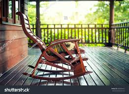 wooden rocking chairs for front porch. Delighful Chairs Wooden Rocking Chair On Front Porch With Pillow  Rocking In Grunge  House With Chairs For Front Porch I