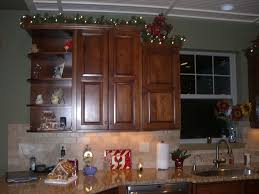 decorating above kitchen cabinets wooden
