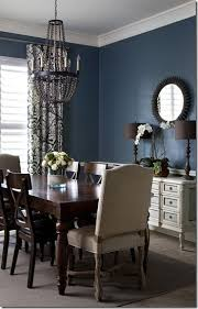 adding two statement chairs to table on the ends to break up the brown table chairs dining room color