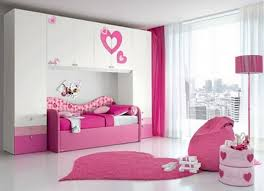 white wooden wardrobe over pink wooden bed added by white pink