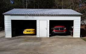 24x30x9 metal garage with two 10x7 roll up steel garage doors in the 30 foot