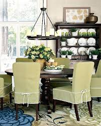 dining room chair slip covers love the dining room love the green slip covers great rug
