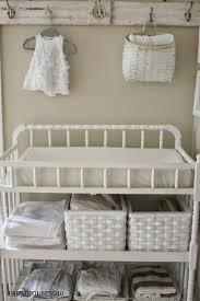 Love the changing table, diaper baskets and linens on the bookshelf