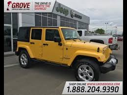 2018 jeep wrangler unlimited sahara 4x4 baja yellow clean carproof 4 door grove dodge you