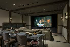 media room paint colorsThis Bright Red Media Room Has A Light Cream Sectional Sofa And An