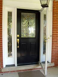 single swing black front door with white window frame also half bevelled glass exterior paneling