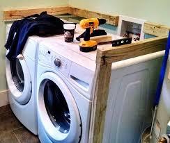 diy laundry room countertop over washer dryer regarding diy remodel 25