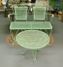 wrought iron vintage patio furniture. Wrought Iron Chairs With Upholstered Cushions At An Outdoor Seating Area. I Love The Curly Back! Vintage Patio Furniture A
