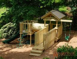 side yard playset on hill side yard play set on a hill with swings slide crawl tunnel and suspension bridge