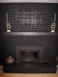 black painted brick fireplace