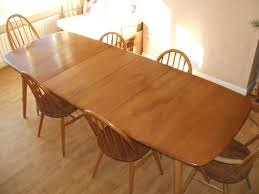 ercol extending dining table and chairs tables