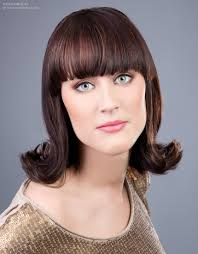 Sixties Hair Style flip hairstyle with an outward roll of the hair 4811 by wearticles.com
