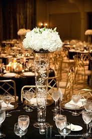 glass vase centerpiece strands of white pearl decorated inside of tall glass vase centerpiece and glass vase centerpiece