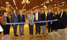 At a ribbon cutting for the Ashley Furniture HomeStore portion of the new plex are Debbie Rydberg left Elk River Chamber of