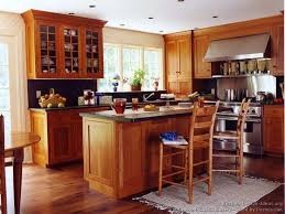 wood cabinet kitchen design. idea of the day: shaker kitchens. (by crown point cabinetry). very nice, light wood cherry island seating floor cabinet kitchen design