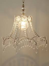 from a lamp shade skeleton to chandelier