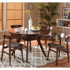 attractive mid century round dining table and chairs