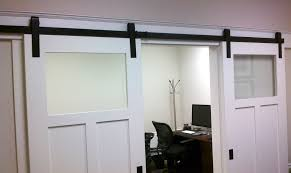 furniture sliding glass door design in white with frosted glass together hanging black iron hardware