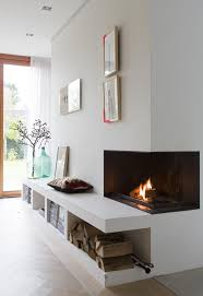 decorate corner fireplace ideas and white wall paint color with creative shelf design also using elegant curtains decoration for glass door