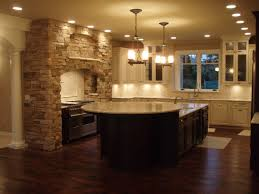 neo classical kitchen design with dark tone wooden island under two chandelier having three frosted