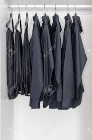 Shirts And Pants Row Of Black Shirts And Pants Hanging On Coat Hanger In White