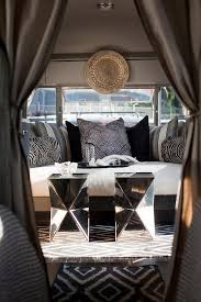 moroccan style camper with gray walls hammered metal moroccan tray west elm kilim kite rug west elm faceted mirror side tables daybed with zebra pillows
