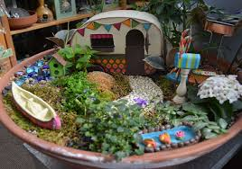 fairy gardens can be built in a container or into an outdoor landscape with some imagination and some fun accessories you can create a magical fairy