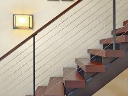 ... Sconce lighting on floating staircase with cherry wood treads ...