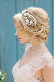 your guide for summer wedding hair and make up Summer Wedding Hair And Makeup bridal hairstyles messy bun with flowers Summer Wedding Hairstyles