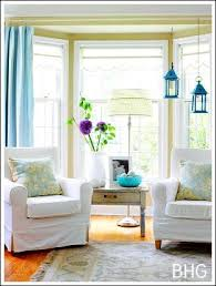 how to style and decorate a bay window with 2 chairs and a side table and