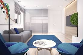 living room lovely gray and blue living room design using swell gray sofa and also lights wood floors an blue area rug plus small round table and