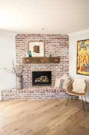 custom brick fireplace with antique white mortar and custom reclaimed barn wood mantel as featured