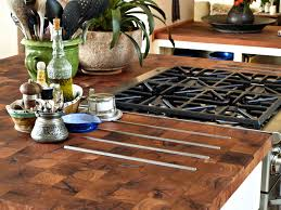mesquite parquet style island top with integrated trivet using stainless steel bars