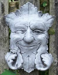 stone garden ornament plaque pagan