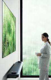 lg wallpaper tv. the thin \u201cwallpaper\u201d tv is designed to look like a poster. lg wallpaper tv u