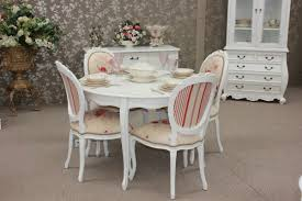 dining room a french country round table and chairs in
