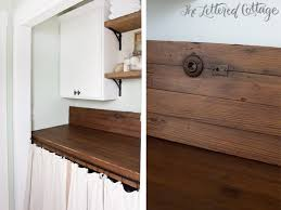 laundry room makeover old door as countertop reclaimed wood shelves
