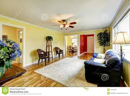 Yellow And Red Living Room Bright Living Room With Yellow And Red Walls Stock Photo Image