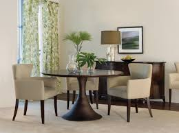 modern minimalist round espresso dining table with curved wood pedestal base and upholstered armchairs gorgeous