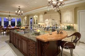 black kitchen chandelier over brown marble top large kitchen island with storage also white painted kitchen cabinet