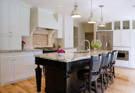 modern kitchen granite countertops island tail backsplash stainless appiances spacious