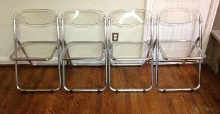 four sets of folded lucite chairs with transpa seating and back panels brushed hardwood