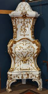 Scadinavian Ceramic Gilt Decorated Kachelofen 19th Century Having A Highly Decorated Case With Foliate Accents Above A Hinged Doo