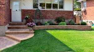 attractive mordern front yard wall designs with white and brown fencebined green grass arround