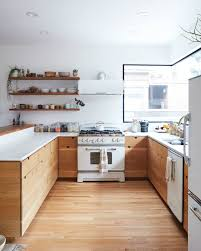 Kitchens with white appliances Updated Retro White Kitchen Appliances In Kitchen With Wood Cabinets And White Countertops Architectural Digest The Secret To Making White Kitchen Appliances Look Chic