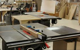 dado cut table saw. three saw-stop table saws - set up for dado, cross cut, and rip. front is with dado blades sacrificial fence. cut saw
