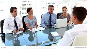 business team giving a job interview to a business etoque de alt video business team giving a job interview to a business