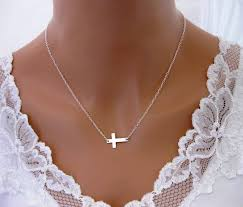 sideways cross necklace meaning